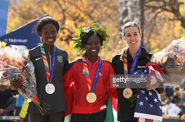 Firstplace finisher Mary Keitany of Kenya secondplace finisher Sally Kipyego of Kenya and thirdplace finisher Molly Huddle of the United States...