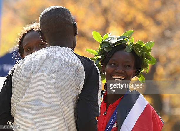 Firstplace Professional Women's finisher Mary Keitany of Kenya smiles as she talks with secondplace Professional Men's finisher Lucas Rotich of Kenya...