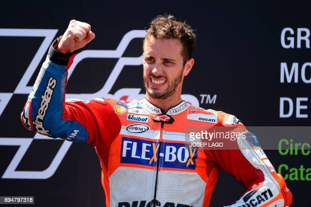 Firstplaced Ducati Team's Italian rider Andrea Dovizioso celebrates on the podium after winning the Moto GP race of the Catalunya Grand Prix at the...