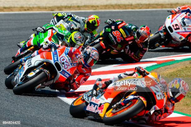 Firstplaced Ducati Team's Italian rider Andrea Dovizioso competes during the MotoGP race of the Moto Grand Prix de Catalunya at the Circuit de...