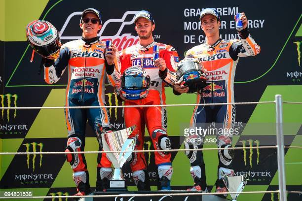 Firstplaced Ducati Team's Italian rider Andrea Dovizioso secondplaced Repsol Honda Team's Spanish rider Marc Marquez and thirdplaced Repsol Honda...