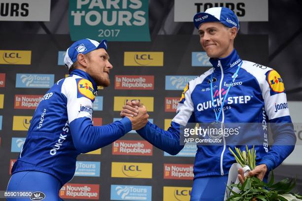 Firstplaced Italian cyclist Matteo Trentin of team Quick Step Floors shakes hands with thirdplaced Dutch Niki Terpstra of team Quick Step Floors as...