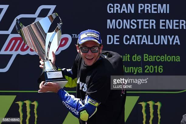 Firstplaced Movistar Yamaha MotoGP's Italian rider Valentino Rossi celebrates on the podium after winning the MotoGP race of the Catalunya Grand Prix...