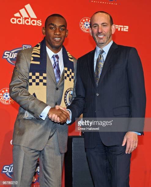 Firstround draft pick Amobi Okugo of the Philadelphia Union and Major League Soccer commissioner Don Garber pose for a photograph during the 2010 MLS...