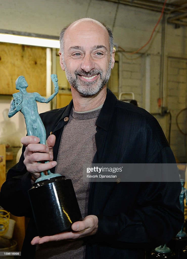First-time actor nominee David Marciano recognized for his ensemble performance in Showtime drama series 'Homeland,' holds up the 16-inch tall award that weighs 12 pounds during the casting of the Screen Actors Guild Award statuettes, at the American Fine Arts Foundry on January 17, 2013 in Burbank, California. The 19th Annual SAG Awards, which honors outstanding motion picture and primetime television performances, are to be held in Los Angeles on January 27.