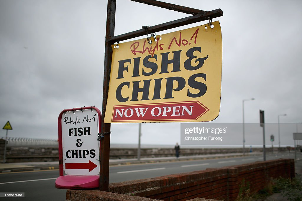 A fish and chip shop sign tries to entice customers on Rhyl Promenade on August 5, 2013 in Rhyl, Wales. The think tank The Centre for Social Justice (CSJ) has today said that some British seaside towns such as Rhyl in North Wales were becoming 'dumping grounds' for vulnerable people. The report 'Turning the Tide' has monitored conditions in five seaside towns, Rhyl in Denbighshire, Margate in Kent, Clacton-on-Sea in Essex, Blackpool in Lancashire and Great Yarmouth in Norfolk. In one area of Rhyl, over 66% of working-age people were found to be dependent on out-of-work benefits.