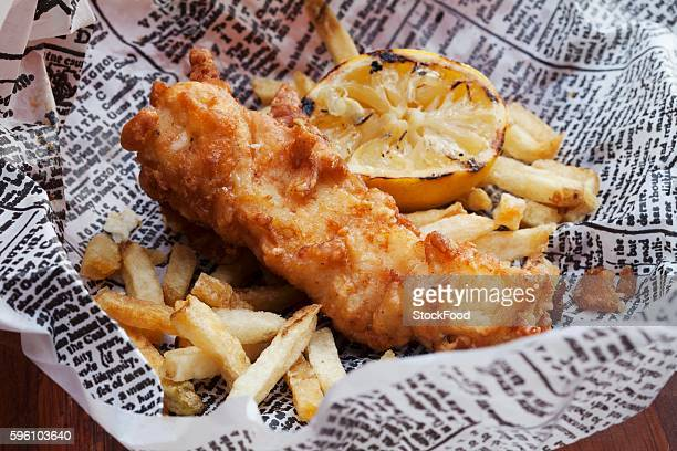 Fish and Chips with Lemon on Newspaper