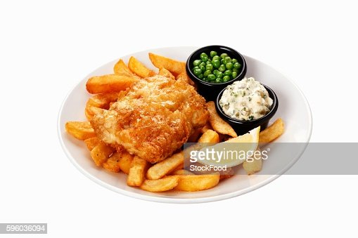 Fish and chips with tartare sauce and peas on plate
