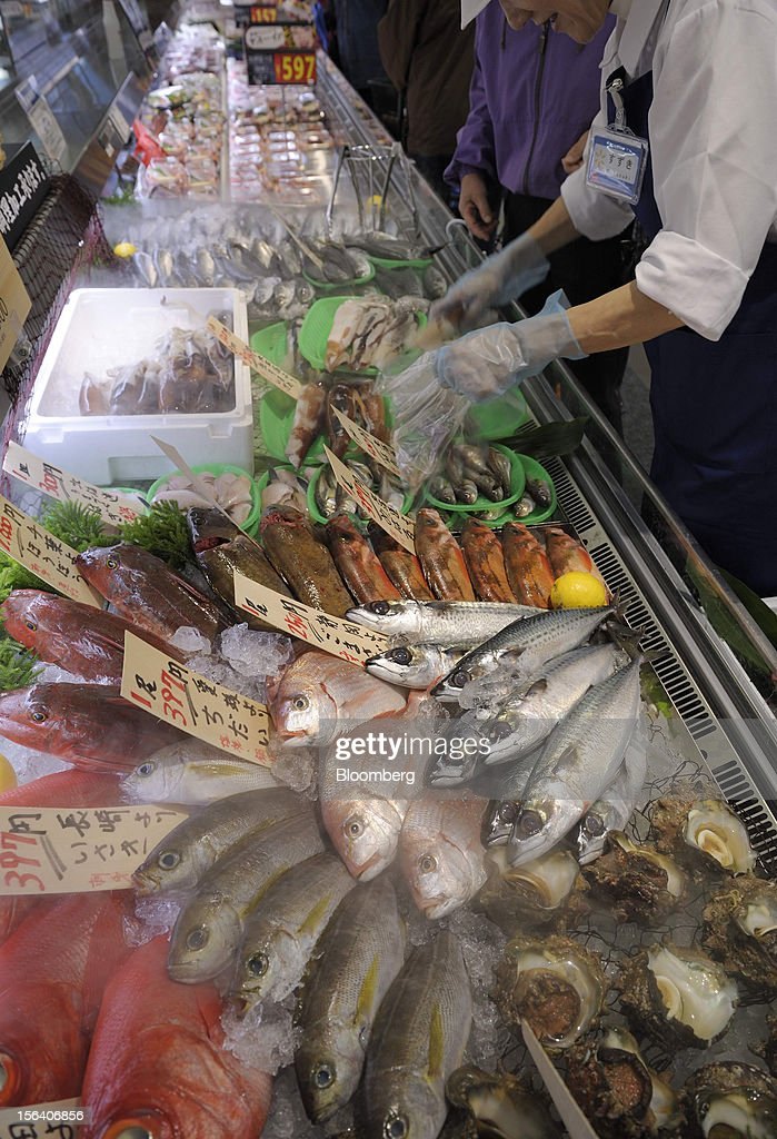Fish are displayed for sale in a Seiyu GK supermarket in Tokyo, Japan, on Wednesday, Nov. 14, 2012. Seiyu GK is a unit of Wal-Mart Stores Inc. Photographer: Akio Kon/Bloomberg via Getty Images