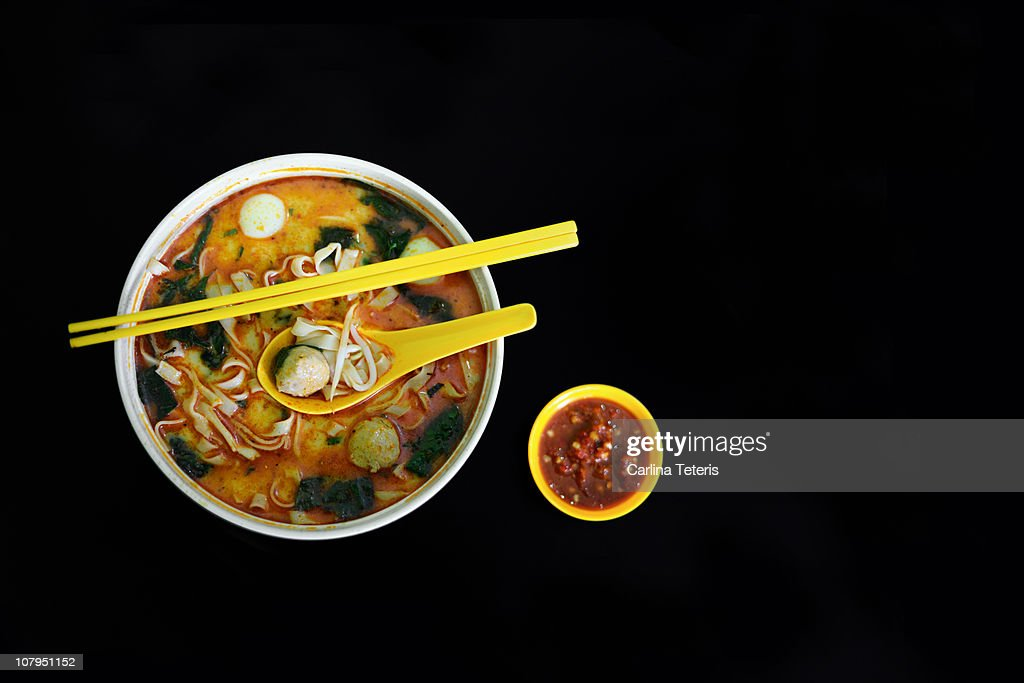 Fish ball noodle bowl with chili sauce : Stock Photo