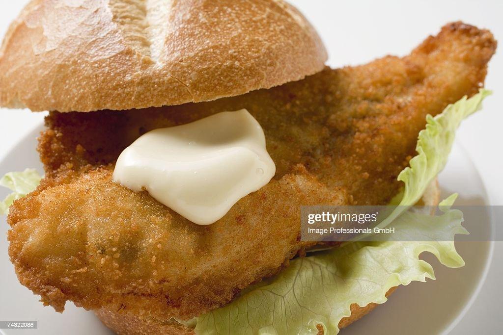 Fish burger with mayonnaise : Stock Photo