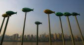 Fish decorations are seen before the city skyline on September 19 2007 in Chongqing Municipality China China's property investmen rose 29 percent up...