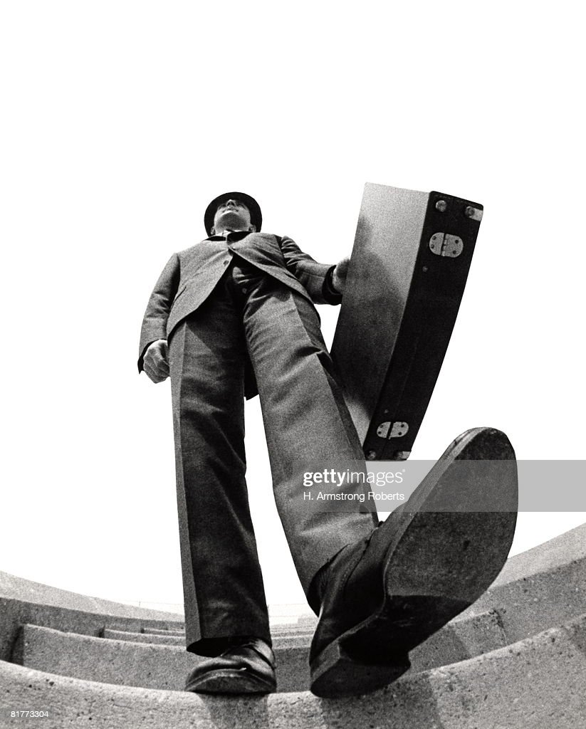 Fish Eye Angle Of Salesman Walking Down Stairs Foot About To Step On Camera Briefcase Elongated Body Distortion Tall Big. : Stock Photo