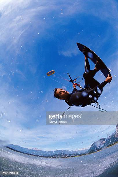 Fish Eye Lens Shot of a Kite Surfer Performing a Stunt in Mid Air