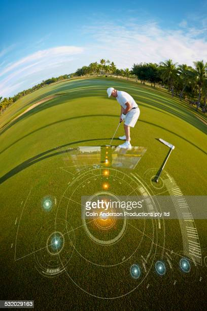 Fish eye view of Caucasian golfer putting on green over hologram