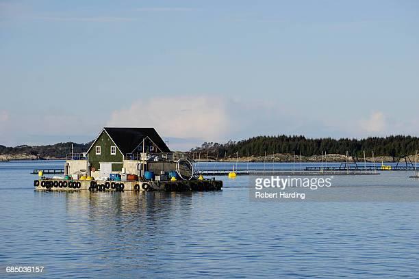 Fish farm with floating house, Aversund Fjord, near Bergen, Hordaland, Norway, Scandinavia