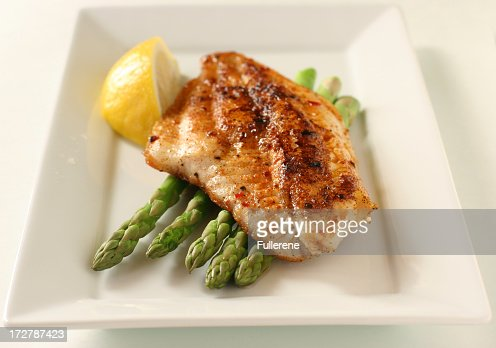 Fish fillet with asparagus and lemon stock photo getty for Fish and asparagus