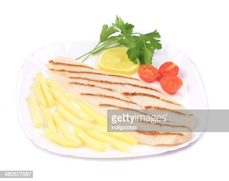 Fish fillet with french fries and herbs. : Stock Photo