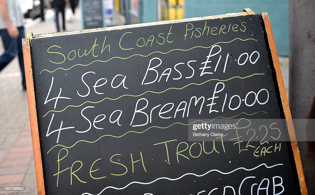 Fish for sale from a high street fish stall in Clapham on September 24, 2013 in London, England. The Labour leader Ed Miliband in his party conference speech has pledged to help small firms by freezing business rates in England. The high street has becoming increasingly full of betting shops, charity shops and pawn brokers replacing independent shops.