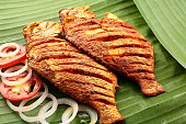 spicy seafood  fish fry served on banana leaf,