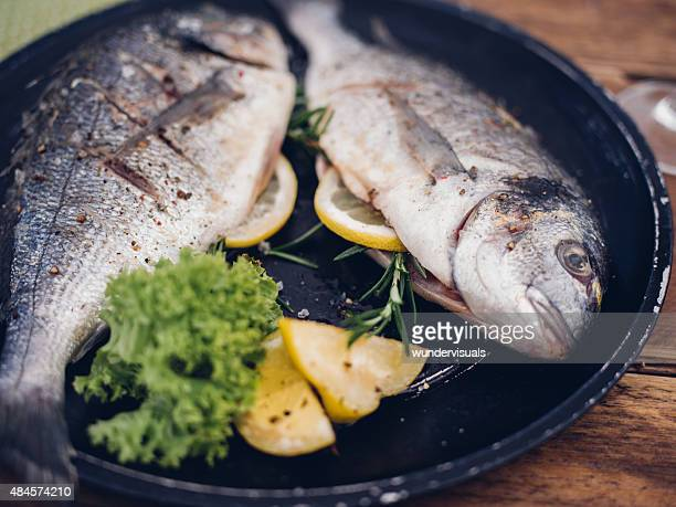 Fish grilled with a stuffing of lemon and rosemary