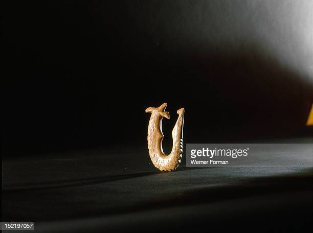 A fish hook of human bone with double inner barb To make a fish hook of an enemy warriors bone would have been a deliberate and especially marked...