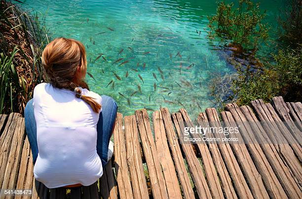 Fish in the green water of Plitvice lake,Croatia
