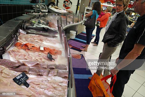 Fish is displayed at a fishmongers section at a supermarket on August 18 2015 in Coutances northwestern France AFP PHOTO/CHARLY TRIBALLEAU