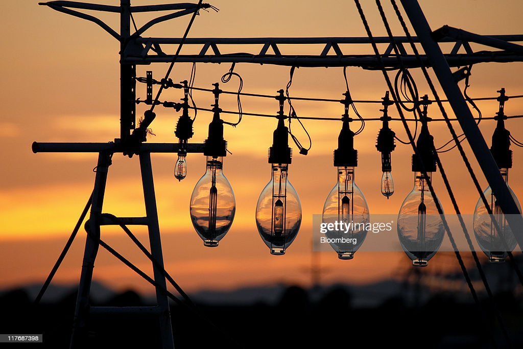 Fish lamps are silhouetted against a sunset at a fishing port in Oma Town, Aomori Prefecture, Japan, on Saturday, June 25, 2011. Over the 29 years since Electric Power Development Co.'s (J-Power) nuclear plant was proposed, Oma has received almost 11 billion yen in subsidies, said Kenichi Ito, a town planning official. In Oma and other Aomori towns, the grants helped offset declining revenues that threatened the survival of rural communities, officials said. Photographer: Kiyoshi Ota/Bloomberg via Getty Images