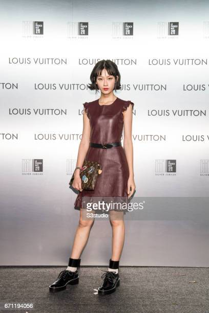 Fish Liew poses at the red carpet during the opening night of the Time Capsule Exhibition by Louis Vuitton on 21 April 2017 in Hong Kong China
