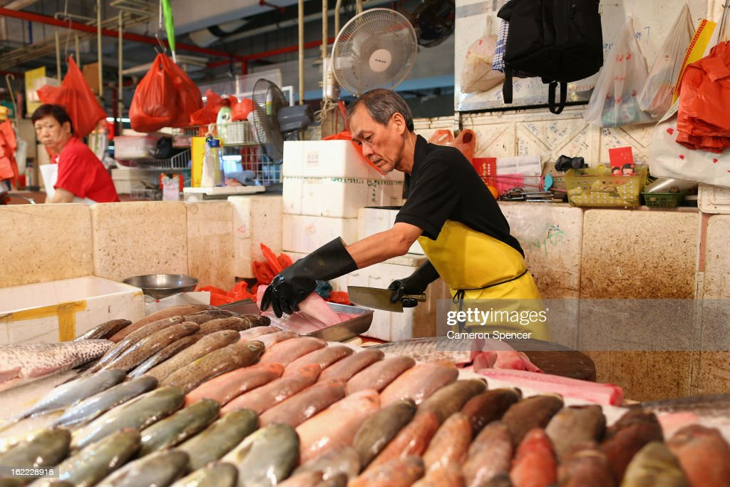 A fish monger fillets a mackerel at the Singapore Chinatown Complex Wet Market on February 21, 2013 in Singapore. The Chinatown Complex Wet Market is a traditional Asian food market popular with elder Singaporeans that features fresh seafood, meat, vegetables, Chinese groceries and a variety of exotic delicacies. The bustling complex floors are never dry with melting ice and water used to clean the floors, fish and vegetables spilling through the space, thus earning the name 'Wet Market'. The markets have retained their relevance by guaranteeing freshness and a personal service between stall mongers and loyal customers.