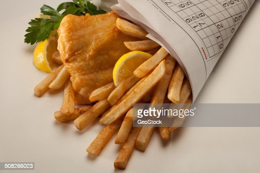 Fish n chips wrapped in newspaper stock photo getty images for Fish and chips newspaper