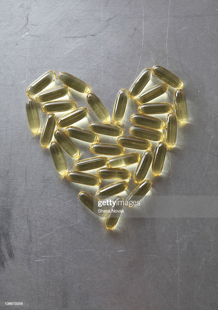 Fish Oil Capsules in the Shape of a Heart : Stock Photo