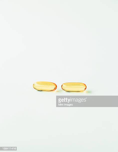 Fish oil providing Omega-3, in soft gel supplement capsules, a health supplement and fatty acid often recommended for health.