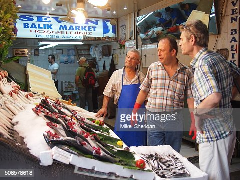 Fish vendor selling fresh fish : Stock Photo