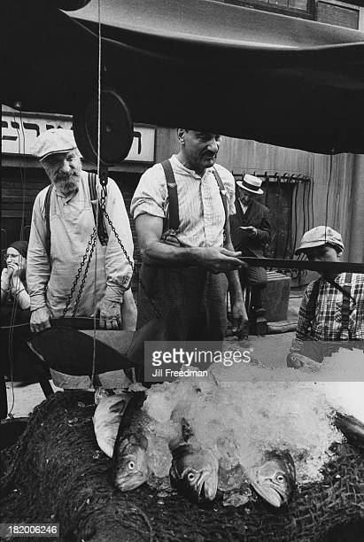 Fish vendors at an outdoor market in the Lower East Side New York City 1978