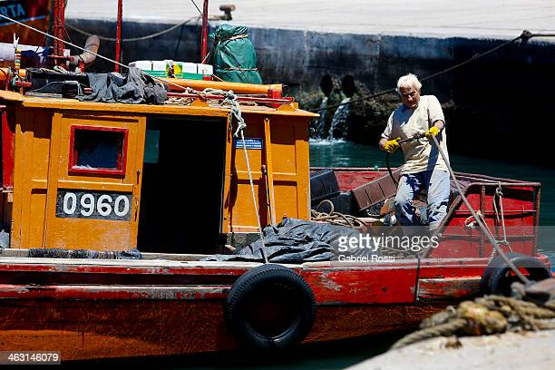 A fisher man is working at Mar del plata Port on Januay 12 2014 in Mar del Plata Argentina The harbor is one of the most traditional tourist...
