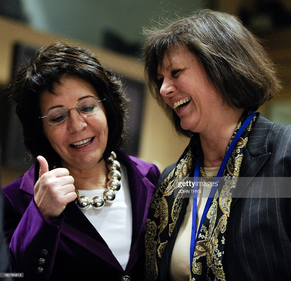 EU fisheries and maritime affairs commissioner Maria Damanaki (L) talks laughs German Agriculture Minister Ilse Aigner before an Agriculture and Fisheries Council meeting at the EU Headquarters in Brussels on February 26, 2013. AFP PHOTO/JOHN THYS