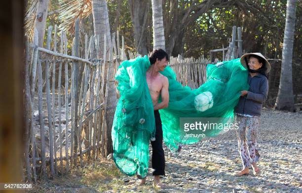 Fisherman and women together happy holding fishing net