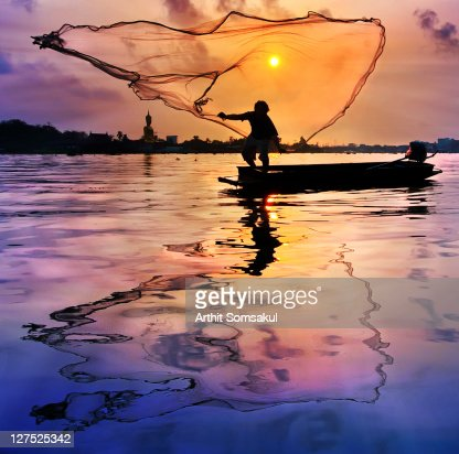 Fisherman at sunset : Stock Photo