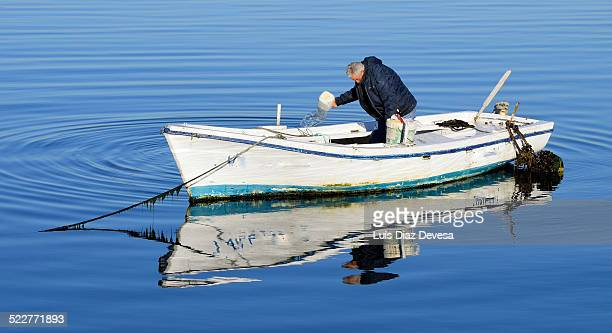 Fisherman bailing out boat