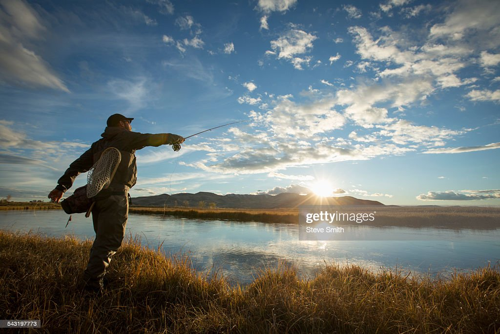 Fisherman casting in river