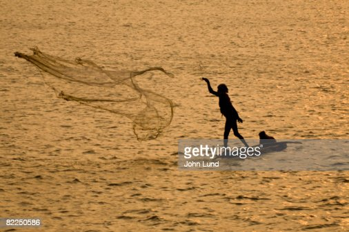 Fisherman casting net in Cochin, India