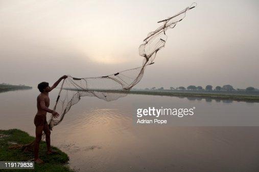 Fisherman casting net : Stock Photo