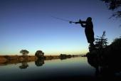 A fisherman casts his line into the Sacramento River in the SacramentoSan Joaquin River Delta on September 29 2005 south of Sacramento California...