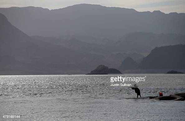 A fisherman casts his line into the waters of Lake Mead near Boulder Beach on May 13 2015 in Lake Mead National Recreation Area Nevada As severe...