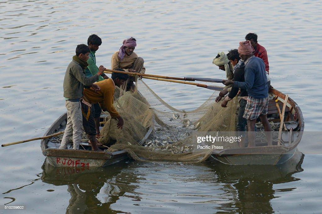 Fisherman catching fish in Anasagar Lake.