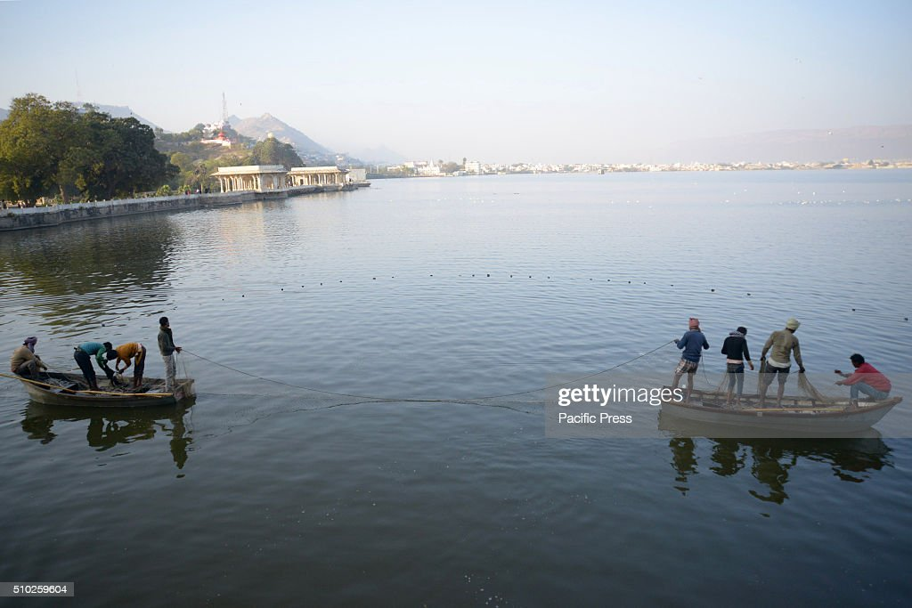 Fisherman catching fish in Anasagar Lake.