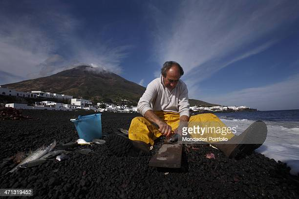 A fisherman cleaning out the fish on the isle of Stromboli in a photo shooting Stromboli Italy April 2007