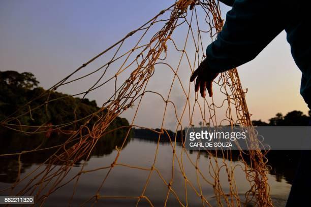 Fisherman Edmilson Ferreira places a net to fish arapaima also known as pirarucu in the Western Amazon region near Volta do Bucho in the Ituxi...